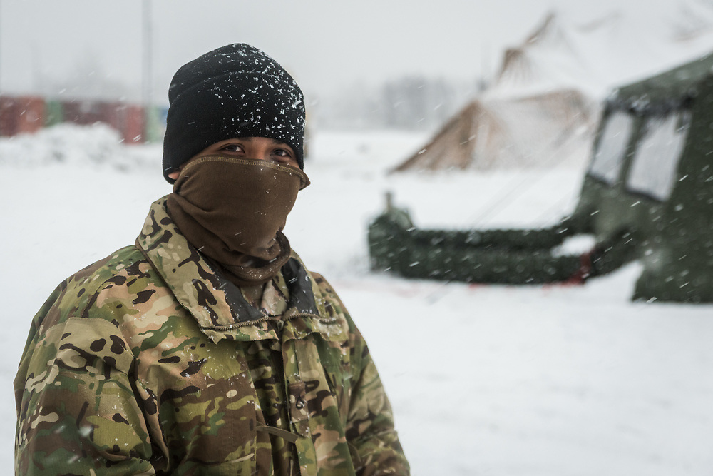 """The weather on Fort Drum can become severe and intensely cold, reaching -17 Fahrenheit during Mountain Peak, but the """"Mountain Tough"""" 10th Mountain Division soldiers persevere to accomplish the mission."""