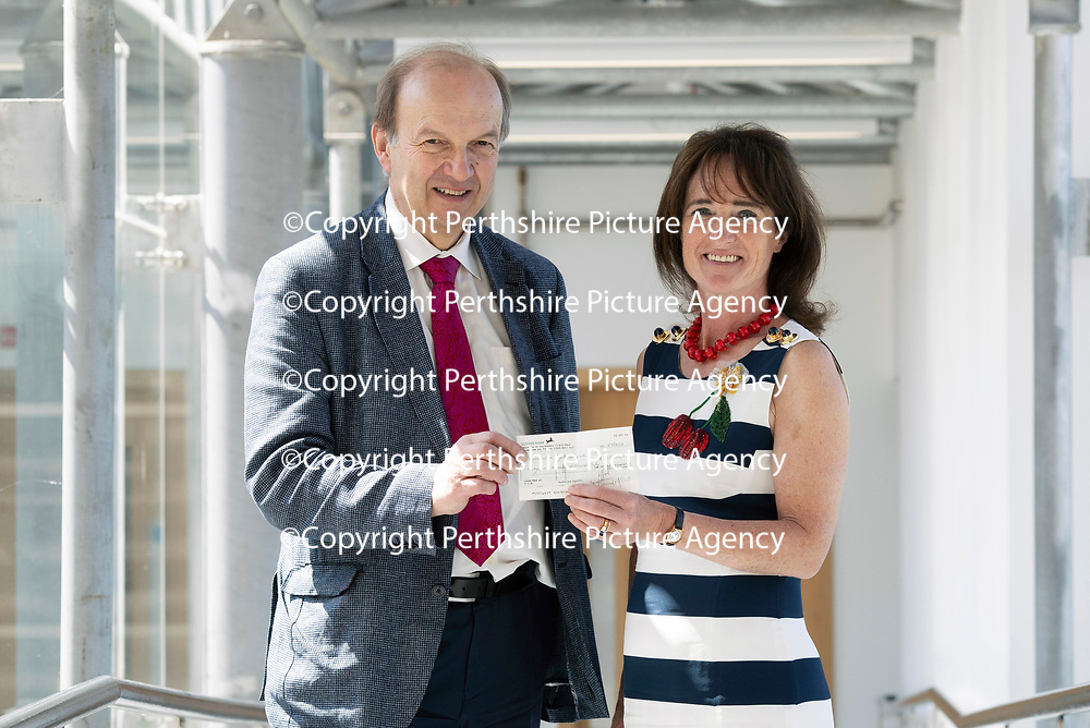 Muscular Dystrophy UK visit to the Biomedical Sciences Research Complex, St Andrews University…<br />Pictured from left  Robert Meadowbank Chief Exec MDUK accepting a donation from Lady Diana Lindsay<br />Picture by Graeme Hart.<br />Copyright Perthshire Picture Agency<br />Tel: 01738 623350  Mobile: 07990 594431