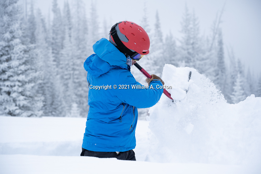 Diamond Peaks Ski Patrol director Owen Richard evaluates snowpack conditions by digging a snow pit near Montgomery Pass, Feb. 6, 2021.