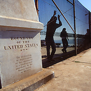 The marker for the Boundary of the United States located at Friendship Park in Imperial Beach, CA. This is about 100 yards from where the border enters the Pacific Ocean.  Migrants gather here to view life on the US side of the border, talk with family, and at times to attempt entry.