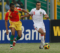 Photo: Steve Bond/Richard Lane Photography.<br />Guinea v Morocco. Africa Cup of Nations. 24/01/2008. Houssine Kharja (R) tries to fend off Kanfory Sylla (L)