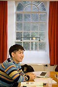 A student in class. The University of Buckingham is unique. It is the only independent university in the UK with a Royal Charter, and probably the smallest with just around 1000 students. Honours degrees are achieved in two intensive years of study. The University campus is well known for being one of the most attractive locations in the region. The Great Ouse river, home to much wildlife, winds through the heart of our campus. Much of our teaching takes place in our restored buildings. Each student mixes with 89 other different nationalities and so being at Buckingham is just like being in a mini global village.