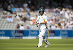 South Africa's Heino Kuhn leaves the field after losing his wicket during day two of the First Investec Test match at Lord's, London.