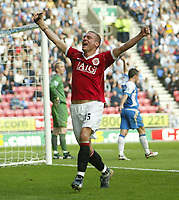 Photo: Aidan Ellis.<br /> Wigan Athletic v Manchester United. The Barclays Premiership. 14/10/2006.<br /> united's Nemanja Vidic celebrates his equaliser