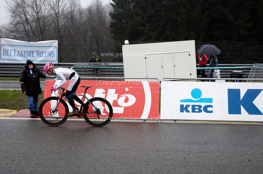 Belgium, Sunday 13th December 2015: A rider ascends the steep Raidillon corner part of the Spa Francorchamps motor racing circuit during the women's race at the Hansgrohe Superprestige cyclocross 2015 event.<br /> <br /> Copyright 2015 Peter Horrell