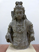 The Budhisattva Maitreya (100-400) Kushan period. A bodhisattva is a future Buddha who is on the path to enlightenment but chooses to remain on earth to help others find salvation.  Bodhisattvas are usually depicted wearing princely dress and jewellery. Her Maitreya also displays the signs of potential Buddhahood, including the raised hair knot and the forehead mark.