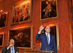 The Duke of Cambridge raises a toast as he attends a reception at Buckingham Palace in London marking the 50th anniversary of the Kennedy Memorial Trust, a scholarship programme set up in memory of John F Kennedy.