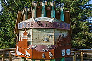 Cape Meares State Scenic Viewpoint welcome sign with symbolic animal cut-outs, Oceanside, Oregon coast, USA.