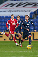 Harry Paton sets off for Ross County during the Scottish Premiership match between Ross County FC and Aberdeen FC at the Global Energy Stadium, Dingwall, Scotland on 16 January 2021.