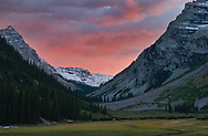 The clouds catch the last light over Maroon Pass filled with fresh snow.