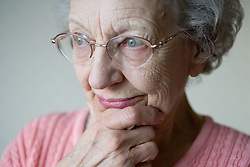 Portrait of a older woman looking thoughtful,