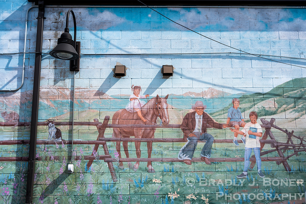 While the Morton family's Sundance Inn was razed in 2011, the family commissioned local artist Greta Gretzinger to paint a mural on an exterior wall on the back side of the Wort Shops, near where the inn once stood. This section of the mural includes an 11-year-old Hailey, right, her brother Cooper and sister Sally, several family pets, and Homer Richards, who originally built and owned the Sundance.