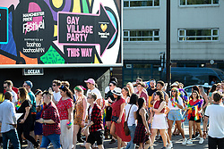 © Licensed to London News Pictures . 25/08/2019. Manchester, UK. Fans of Ariana Grande and other musical acts gather at Mayfield Depot ahead of performances this evening . Manchester's annual Gay Pride festival , which is the largest of its type in Europe , celebrates LGBTQ+ life . Photo credit: Joel Goodman/LNP