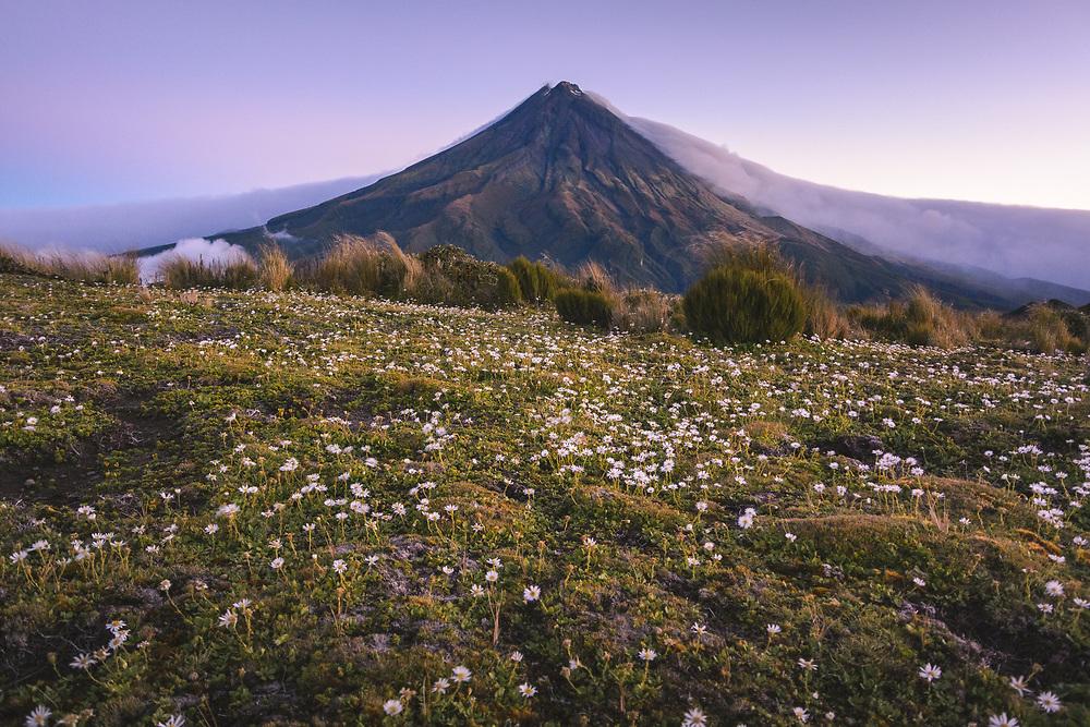 Cloud front from ocean climbs over Mount Taranaki, Egmont National Park, New Zealand Ⓒ Davis Ulands   davisulands.com