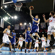 Anadolu Efes's Cedi Osman (2ndR) and Real Madrid's Sergio Llull (R) during their Turkish Airlines Euroleague Basketball Group A Round 5 match Anadolu Efes between Real Madrid at Abdi ipekci arena in Istanbul, Turkey, Thursday, November 14, 2014. Photo by Aykut AKICI/TURKPIX