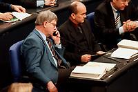 20 JAN 2000, BERLIN/GERMANY:<br /> Joachim Hörster, CDU, Parl. Geschäftsführer der CDU/CSU Fraktion, telefoniert, während der Debatte zur CDU Spendenaffäre, Plenum, Deutscher Bundestag<br /> IMAGE: 20000120-01/01-29<br /> KEYWORDS: Telefon, phone, telephone, Joachim Hoerster