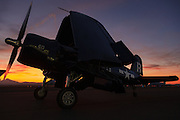 F4U-7 Corsair of the Erickson Aircraft Collection parked in front of the sunset at the Airshow of the Cascades.