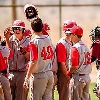 Grants Pirate Austin Hall (5) gets a heroes welcome after a homer on the Sandia Prep Sundevils in Grants Tuesday.