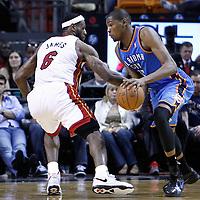 16 March 2011: Oklahoma City Thunder small forward Kevin Durant (35) drives past Miami Heat small forward LeBron James (6) during the Oklahoma City Thunder 96-85 victory over the Miami Heat at the AmericanAirlines Arena, Miami, Florida, USA.
