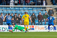 Oxford United goalkeeper Simon Eastwood (1) saves a penalty kick from Gillingham FC forward Tom Eaves (9) during the EFL Sky Bet League 1 match between Gillingham and Oxford United at the MEMS Priestfield Stadium, Gillingham, England on 9 March 2019.