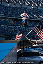 Doug Danger does a huge car jump at the Daytona Speedway during Daytona Bike Week. Daytona Beach, FL. USA. Thursday March 15, 2018. Photography ©2018 Michael Lichter.