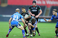 Keelan Giles of the Ospreys © is tackled by Lewis Evans ®  and Sarel Pretorius (21) of the Newport Gwent Dragons .Guinness Pro12 rugby match, Ospreys v Newport Gwent Dragons at the Liberty Stadium in Swansea, South Wales on 29th October 2016.<br /> pic by Andrew Orchard, Andrew Orchard sports photography.