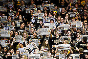 SHOT 2/14/13 8:01:12 PM - Colorado basketball fans hold up newspapers ignoring the announcement of Arizona's starters prior to their regular season Pac-12 basketball game at the Coors Event Center on the Colorado campus in Boulder, Co. Colorado won the game 71-58. The student cheering section is nicknamed the C-Unit. (Photo by Marc Piscotty / © 2013)