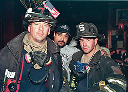 18 September 2001. New York, New York - USA.<br /> Post 9/11 World Trade Center attack.<br /> John Philips (center) meets with a couple of firefighter rescue workers, Greg Conlan (L) and Scott Parkin (rt) as he hands out posters for his missing sister Sneha who was last seen around the World Trade Centre moments before the first plane hit the Twin Towers. Despite working a 16 hour shift digging through the rubble of the World Trade Centre, the firemen insisted on giving John $15 for him to print more posters. They also took some with them to hand around on site just in case anyone should come across Sneha. Earlier in the day John been granted special permission to enter his once luxury apartment 2 blocks from where the World Trade Center Twin Towers used to stand. His apartment is now filled with dust and debris from the collapsed towers. John and residents of the building were evacuated following the attack which cut off water and electricity supplies. A week after the attack, residents were given just 15 minutes to gather necessary belongings and leave their apartments which by default rendered them homeless, perhaps the first refugees of the War on Terror. Residents were warned to check their balconies for victims of the Twin Towers who might have fallen to their deaths.<br /> In the chaos of 9/11, John's sister Dr Sneha Ann Philip disappeared. John claimed she used to walk past the Twin Towers every morning on her way to work. He fears she might be a victim of the coordinated Al Qaeda attack which claimed over 2,000 victims at the site of the Twin Towers.<br /> It was later discovered that his sister was perhaps one of the earliest victims killed in the attack.<br /> Photo exclusive©; Charlie Varley/varleypix.com