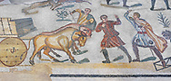 Ambulatory of the Great Hunt Roman mosaic, Wagons being pulled by bullocks, room no 28, at the Villa Romana del Casale, first quarter of the 4th century AD. Sicily, Italy. A UNESCO World Heritage Site.<br /> <br /> The Great Hunt ambulatory is around 60 meters long (200 Roman feet) and connects the master's northern apartments with the triclinium in the south. The door in the centre of the the Great Hunt ambulatory leads to audience hall. <br /> <br /> The Great Hunt Roman mosaic depicts African animals being hunted and put onto ships to be taken to the Colosseum. .<br /> <br /> If you prefer to buy from our ALAMY PHOTO LIBRARY  Collection visit : https://www.alamy.com/portfolio/paul-williams-funkystock/villaromanadelcasale.html<br /> Visit our ROMAN MOSAICS  PHOTO COLLECTIONS for more photos to buy as buy as wall art prints https://funkystock.photoshelter.com/gallery/Roman-Mosaics-Roman-Mosaic-Pictures-Photos-and-Images-Fotos/G00008dLtP71H_yc/C0000q_tZnliJD08