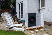 Air source heat pump installers from Solaris Energy installing a Vaillant Arotherm plus 7kw air source heat pump unit into a 1930's built house in Folkestone, United Kingdom on the 20th of September 2021.  With gas prices increasing and the increasing need to reduce fossil fuel air source heat pumps are slowly starting to replace the gas boiler use in properties in the UK.