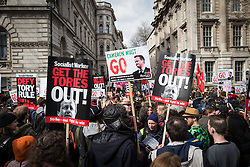 © Licensed to London News Pictures. 09/04/2016. London, UK. Thousands gather on Whitehall to demand that British Prime Minister David Cameron resign after he admitted to profiting from the sale of shares worth more than £30,000 in Blairmore Holdings, an offshore investment fund set up by his late father Ian Cameron. The Panama Papers, leaked anonymously from the database of law firm Mossack Fonseca, have revealed the extent to which firms and wealthy individuals use loopholes and offshore funds to avoid paying tax. Photo credit: Rob Pinney/LNP