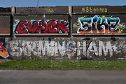 Old graffiti of the word Birmingham beneath more recent works on 31st March 2021 in Birmingham, United Kingdom. The graffiti, which seems to pre-date street art as we know it, has been left in tact with respect to its vintage.