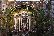 The ruins of the naive in the San Juan Parangaricutiro church partly buried in a sea of dried lava rock in the remote village of San Juan Parangaricutiro, Michoacan, Mexico. This church is the only remaining structure left buried in the eight-year eruption of the Paricutin volcano which consumed two villages in 1943 and covered the region in lava and ash.
