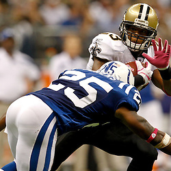 October 23, 2011; New Orleans, LA, USA; Indianapolis Colts cornerback Jerraud Powers (25) hits New Orleans Saints running back Pierre Thomas (23) during the third  quarter of a game at the Mercedes-Benz Superdome. The Saints defeated the Colts 62-7. Mandatory Credit: Derick E. Hingle-US PRESSWIRE / © Derick E. Hingle 2011