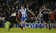 Brighton winger, Jamie Murphy (15) gets a shot away during the Sky Bet Championship match between Brighton and Hove Albion and Brentford at the American Express Community Stadium, Brighton and Hove, England on 5 February 2016.
