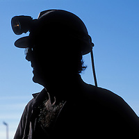 Australia, New South Wales, (MR) Mike Rounce silhouetted against blue sky at Macquarie Coal's Teralba Colliery in Newcastle.
