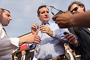 U.S. Senator Ted Cruz and GOP presidential candidate has microphones attached before talking to the local media following a town hall meeting at the famous Beacon Drive-in restaurant before April 3, 2015 in Spartanburg, South Carolina.