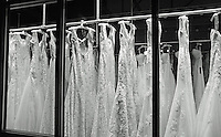 wedding dresses in window on broadway avenue in denver, colorado.