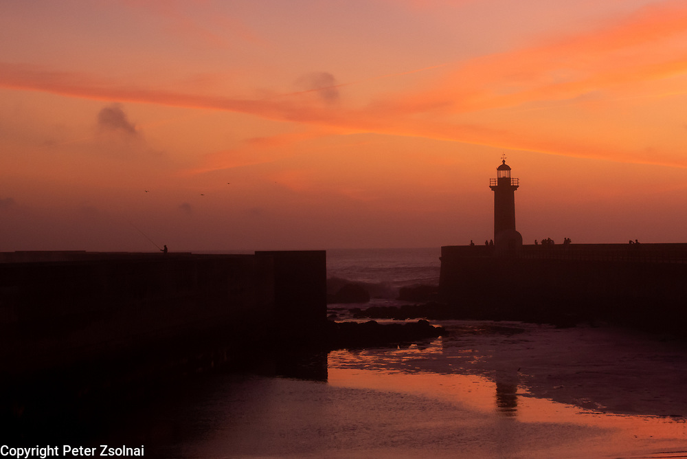 A lighting tower in Porto during sunset