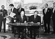 New Fianna Fáil Administration Sworn In.  (R52)..1987..10.03.1987..03.10.1987..10th March 1987..After their win in the recent general election the new Fianna Fáil government,under the leadershio of Charles Haughey, was sworn in and given their seals of offce at a ceremony in Áras an Uachtaráin today. The government received their seals from President Patrick Hillery...President Patrick Hillery and Charles Haughey, Taoiseach and leader of Fianna Fáil, are pictured signing  the documents investing the new government.