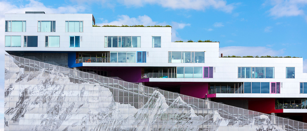 Ultra-modern new apartments with mountain range below on Orestads Boulevard, Copenhagen, Denmark