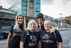 © Licensed to London News Pictures . 09/09/2017. Manchester , UK . Concert goers Samantha Neeham , Sarah Scott , Gemma Jones and Jodie Knapper arrive at the venue . We Are Manchester reopening charity concert at the Manchester Arena with performances by Manchester artists including  Noel Gallagher , Courteeners , Blossoms and the poet Tony Walsh . The Arena has been closed since 22nd May 2017 , after Salman Abedi's terrorist attack at an Ariana Grande concert killed 22 and injured 250 . Money raised will go towards the victims of the bombing . Photo credit: Joel Goodman/LNP