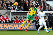 Norwich's Russell Martin clears with a header. Barclays Premier league match, Swansea city v Norwich city at the Liberty Stadium in Swansea, South Wales on Saturday 5th March 2016.<br /> pic by  Carl Robertson, Andrew Orchard sports photography.