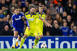 Eden Hazard of Chelsea vs Marko Suler of Maribor during football match between Chelsea FC and NK Maribor, SLO in Group G of Group Stage of UEFA Champions League 2014/15, on October 21, 2014 in Stamford Bridge Stadium, London, Great Britain. Photo by Vid Ponikvar / Sportida.com