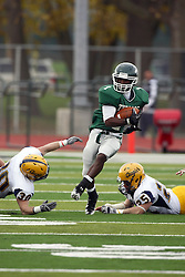 12 November 2011:  Cameron Allen escapes the grasps of Danny Hess and Mitch McGilliard during an NCAA division 3 football game between the Augustana Vikings and the Illinois Wesleyan Titans in Tucci Stadium on Wilder Field, Bloomington IL
