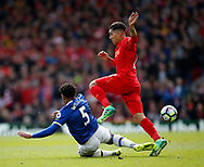 Ashley Williams of Everton tackles Roberto Firmino of Liverpool during the English Premier League match at Anfield Stadium, Liverpool. Picture date: April 1st 2017. Pic credit should read: Simon Bellis/Sportimage