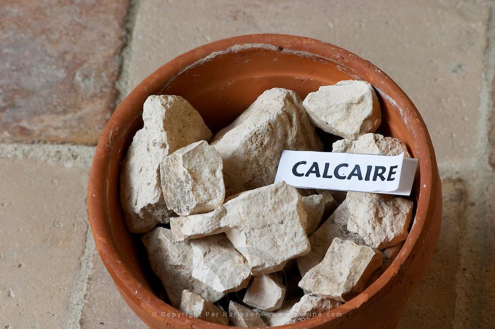 Plant pot with soil sample to illustrate different soil types, part of a series: calcareous calcium carbonate rock, calcaire. Chateau Villerambert-Julien near Caunes-Minervois. Minervois. Languedoc. Terroir soil. France. Europe. Calcareous limestone.