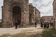 An Armenian priest walks out of the Church of St. Grigor Lusavorich, or St. Gregory the Illuminator, at Tatev monastery in Armenia. The church was first built in the 9th century and rebuilt in later centuries. (October 1, 2016)