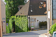 A street with village houses and road signs to Epernay, Cumieres and the Route de Champagne (the touristique tourist wine route of Champagne), the village of Hautvillers in Vallee de la Marne, Champagne, Marne, Ardennes, France