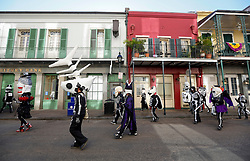 09 February 2016. New Orleans, Louisiana.<br /> Mardi Gras Day. Walking with Skeletons in the French Quarter. The Skeleton Krewe meet before sunrise and walk 5 miles from Uptown, making their way along St Charles Avenue and into the French Quarter where they celebrate Mardi Gras Day.<br /> Photo©; Charlie Varley/varleypix.com